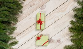 Multi-colored gift boxes and spruce branches on a wooden background. Christmas background, top view. Flat lay. Christmas gift box. Holiday greeting card. Copy royalty free stock image