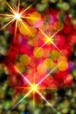 Multi-colored gloeiende achtergrond. Kerstkaart. Royalty-vrije Stock Afbeelding