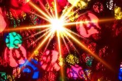 Multi-colored gloeiende achtergrond. Kerstkaart. Stock Foto