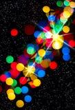 Multi-colored gloeiende achtergrond. Kerstkaart. Stock Afbeeldingen