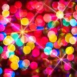 Multi-colored gloeiende achtergrond. Kerstkaart. Royalty-vrije Stock Foto's