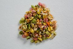 Multi-colored granola on white background Royalty Free Stock Photo