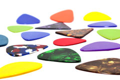 Multi-colored guitar pick. On a black background Stock Photo