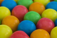 Multi-colored gum-balls. Closeup of multicolored gum-balls royalty free stock image