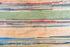 Multi-colored hand-made carpet from fabric stock photography