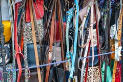 Multi-colored handbags and belts handmade in the window of a street vendor royalty free stock photos