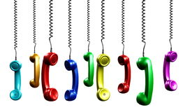 Multi colored handsets Royalty Free Stock Image