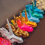 Multi-colored heads of unicorns. White, pink, blue, gold. Multi-colored heads of unicorns. White, pink, blue gold stock image