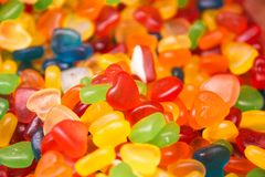 Multi-colored heart-shaped jellies with different taste selective focus royalty free stock image