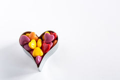 Multi Colored Heart Shaped Valentines Day Candy In Cookie Cutter Royalty Free Stock Photography