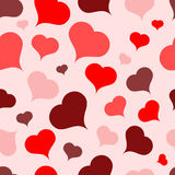Multi-colored hearts on a light background.Seamless.Vector Stock Image