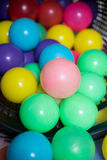 Multi colored highly saturated plastic balls Royalty Free Stock Photography