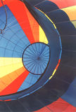 Multi-Colored Hot Air Balloon. Close up shot of hot air balloon lying on its side as it fills with air. Primary colors, lines and angles Royalty Free Stock Images