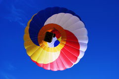 Multi Colored Hot Air Balloon On A Blue Sky 2 Royalty Free Stock Photo