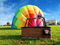 Multi colored hot air balloon with red heart in the field Stock Photography