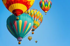 Multi colored hot air balloons stock photo