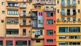 Multi colored houses on the bank of the Onyar River, Girona, Spain stock photo