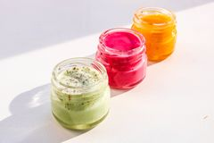 Multi-colored jars with honey souffle stock photos