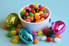 Multi colored jelly beans and Easter eggs Stock Photo