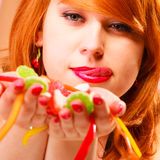 Multi colored jelly sweets in woman hands. Royalty Free Stock Image