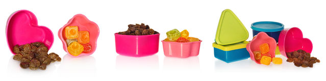 Multi colored kitchen molds with raisins and candy. Box closed in the shape of heart,  star, asquare and a circle. Royalty Free Stock Images