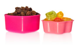 Multi colored kitchen molds with raisins and candy. Box closed in the shape of heart and star. Royalty Free Stock Photography