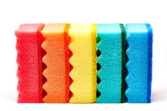 Multi-colored kitchen sponges on a white background stock photos