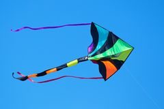 Multi-Colored Kite. Flying in Blue Sky Royalty Free Stock Photos