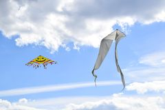Multi colored kites in the blue sky royalty free stock photo