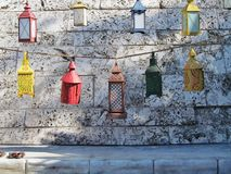 Multi colored lanterns. Colorful lanterns against a rock wall Royalty Free Stock Images