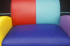Multi colored leather sofa Stock Photos
