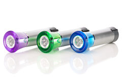 Multi-colored LED flashlights Stock Images