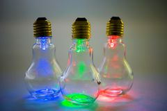 Multi colored light bulbs. Over white Royalty Free Stock Photography