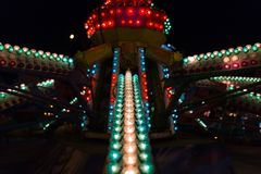 Multi-colored lights on the amusement park at night. stock image