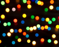 Multi-colored lights on a dark background. Blurring the background Royalty Free Stock Image