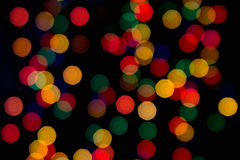 Multi-colored lights on a dark background. Blurring the background Royalty Free Stock Photography