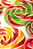 Multi-colored lollypop. Closeup on a white background Stock Photo