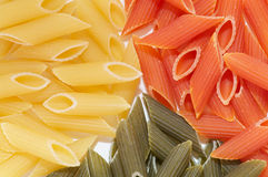 Multi colored macaroni with spices. Multi colored macaroni as background Royalty Free Stock Images