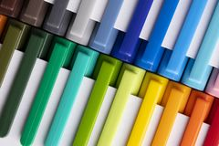 Multi-colored markers in white packaging royalty free stock image