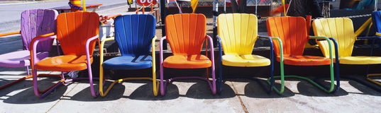 Multi-colored metal lawn chairs. Royalty Free Stock Photos