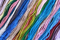 Multi-Colored Mouline Threads. Close-up shot of multi-colored mouline threads lying on the table Stock Photos