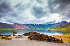 Multi-colored mountains and lake with ice-blue water Stock Images