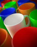 Multi colored mugs. 3D render of a multi colored mugs Royalty Free Stock Image
