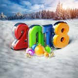 Multi-colored number 2018 and ornaments. 3D illustration. Multi-colored number 2018 and ornaments on snow. 3D illustration Royalty Free Stock Photo
