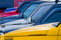 Multi-colored off road cars parked together royalty free stock images