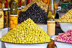 Multi-colored olives and olive oil Royalty Free Stock Images