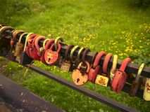 Multi-colored padlocks with the names of the newlyweds, as a symbol of fidelity of the spouses. royalty free stock photos
