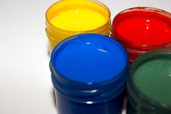 Multi-colored paint to paint the jars royalty free stock images