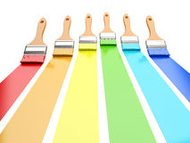 Multi colored paintbrushes isolated on a white Stock Photos