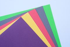 Multi-colored paper. Sheets of multi-colored paper. Colors are bright and are placed in a fan shape Stock Photo